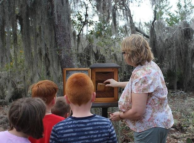 Diane shows visitors the shrine box journal.