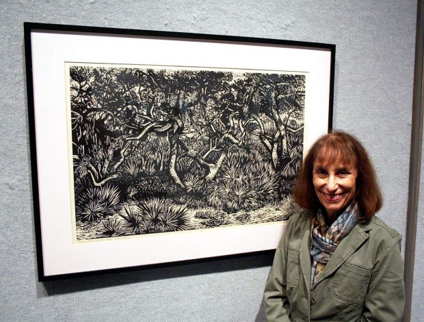 "Mollie Doctrow stands in front of her ""Pygmy Oak Forest,"" one of four woodcuts destined for the ambassador's residence in Niamey, Niger."